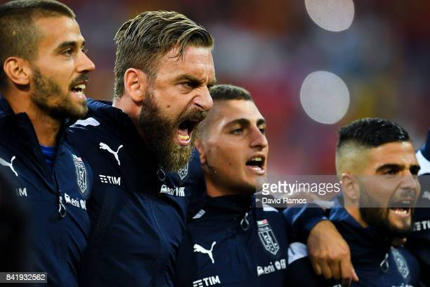 Daniele de Rossi and Marco Verratti of Italy sing the Italy's national anthem prior to the FIFA 2018 World Cup Qualifier between Spain and Italy at...