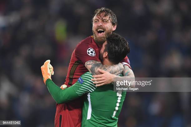 Daniele De Rossi of AS Roma celebrates his sides victory with Alisson Becker of AS Roma after the UEFA Champions League Quarter Final Second Leg...