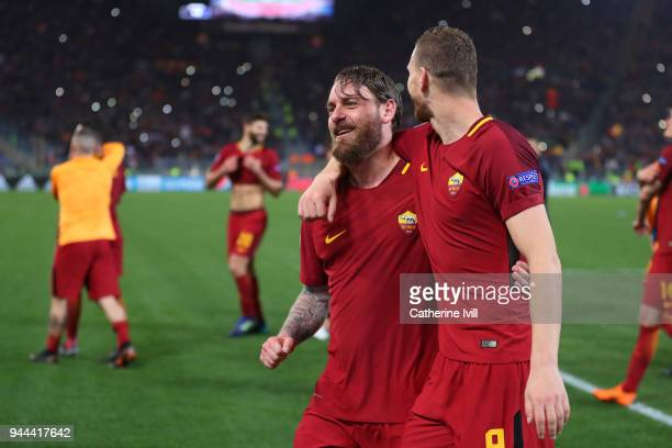 Daniele De Rossi of AS Roma celebrates victory with Edin Dzeko of AS Roma UEFA Champions League Quarter Final Second Leg match between AS Roma and FC...