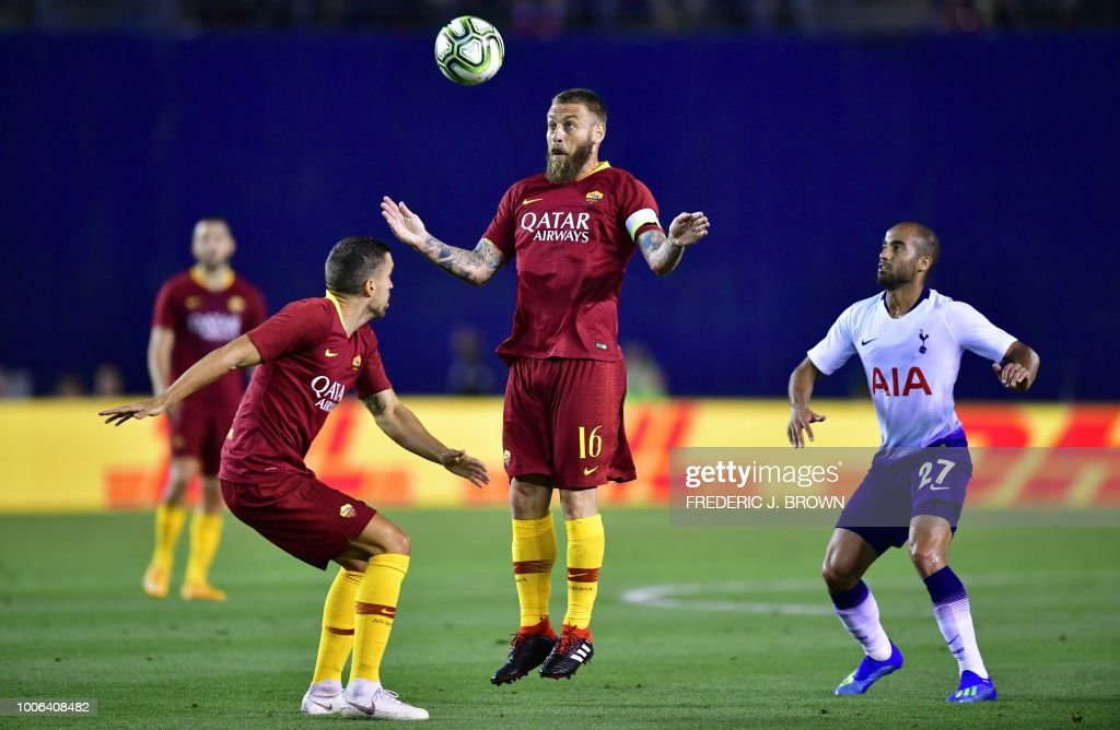 Daniele De Rossi (C) of AS Roma clears the ball as Lucas Moura of Tottenham HOtspur watches in their International Champions Cup match in San Diego, California on July 25, 2018 where Tottenham defeated Roma 4-1.