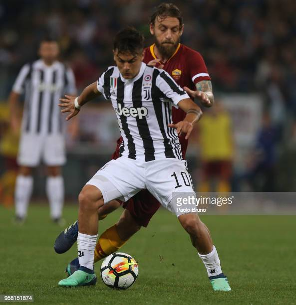 Daniele De Rossi of AS Roma competes for the ball with Paulo Dybala of Juventus during the Serie A match between AS Roma and Juventus at Stadio...