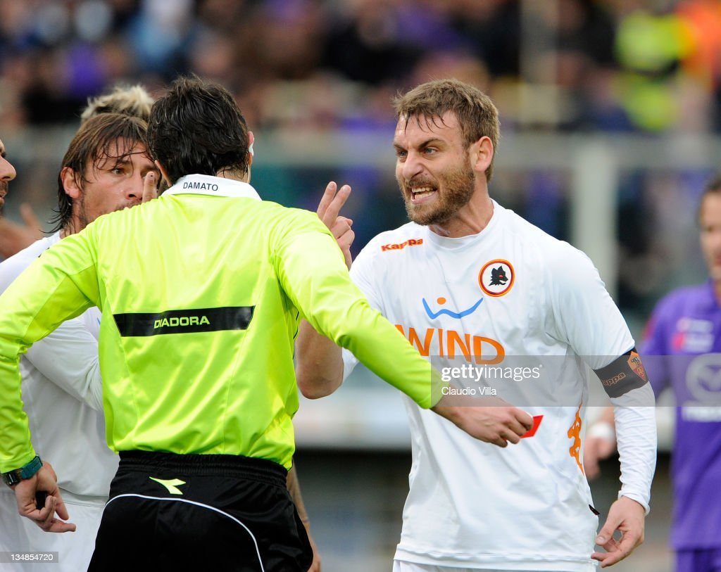 Daniele De Rossi of AS Roma confronts the referee Christian Brighi during the Serie A match between ACF Fiorentina and AS Roma at Stadio Artemio Franchi on December 4, 2011 in Florence, Italy.