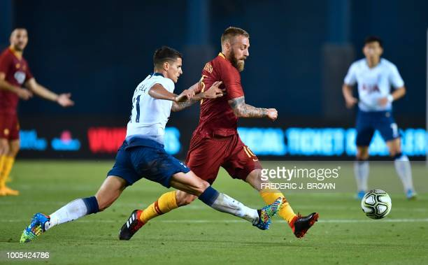 Daniele De Rossi of AS Roma passes under pressure from Erik Lamela of Tottenham Hotspur during their International Champions Cup match in San Diego...