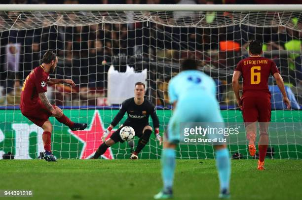Daniele De Rossi of AS Roma scores his side's second goal from the penalty spot during the UEFA Champions League Quarter Final second leg match...