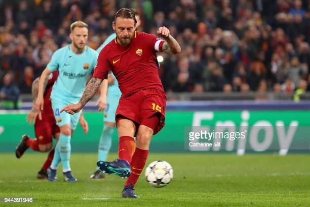 Daniele De Rossi of AS Roma scores his sides second goal from the penalty spot during the UEFA Champions League Quarter Final Second Leg match...