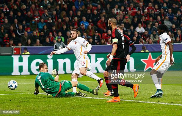 Daniele De Rossi of AS Roma shoots past goalkeeper Bernd Leno of Bayer Levekusen to score their first goal during the UEFA Champions League Group E...