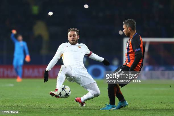 Daniele De Rossi of AS Roma tackles Marlos of Shakhtar Donetsk during the UEFA Champions League Round of 16 First Leg match between Shakhtar Donetsk...