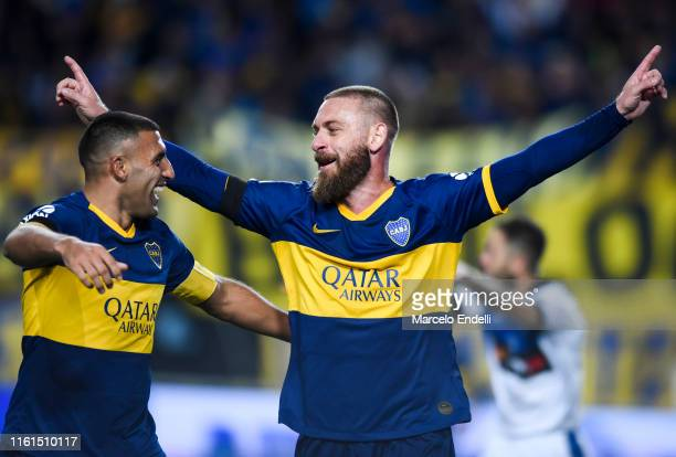 Daniele De Rossi of Boca Juniors celebrates with teammate Ramón Ábila after scoring the first goal of his team during a match between Boca Juniors...