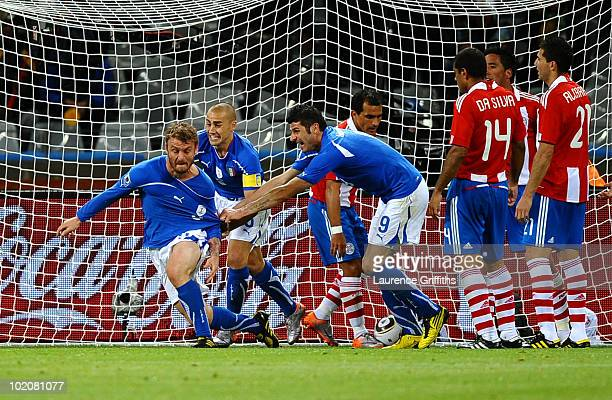 Daniele De Rossi of Italy celebrates scoring his team's first goal with Fabio Cannavaro and Vincenzo Iaquinta during the 2010 FIFA World Cup South...