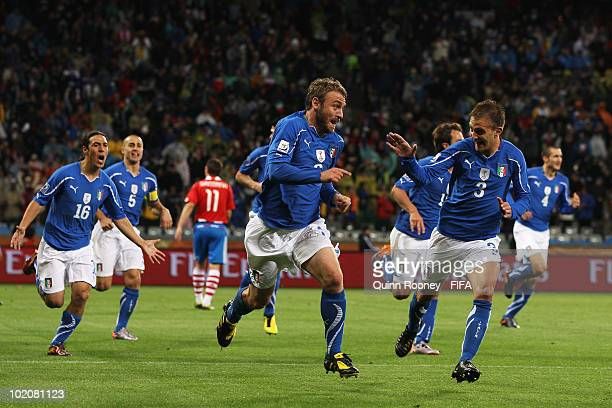Daniele De Rossi of Italy celebrates scoring his team's first goal with Domenico Criscito during the 2010 FIFA World Cup South Africa Group F match...