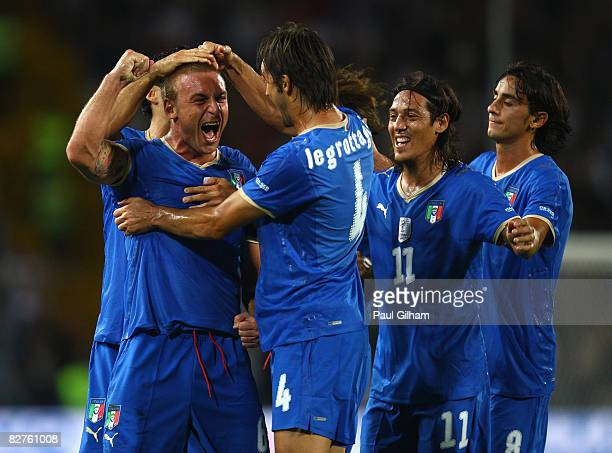 Daniele De Rossi of Italy celebrates scoring the first goal for Italy during the FIFA 2010 World Cup Group Eight Qualifying match between Italy and...