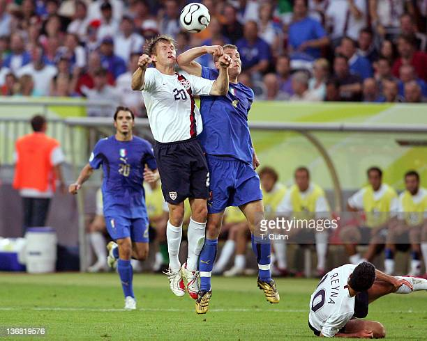 Daniele De Rossi of Italy elbows Brian McBride of the United States in the face and received a red card for the incident during the FIFA 2006 World...