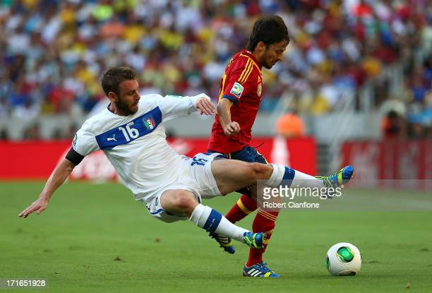 Daniele De Rossi of Italy tackles David Silva of Spain during the FIFA Confederations Cup Brazil 2013 Semi Final match between Spain and Italy at...