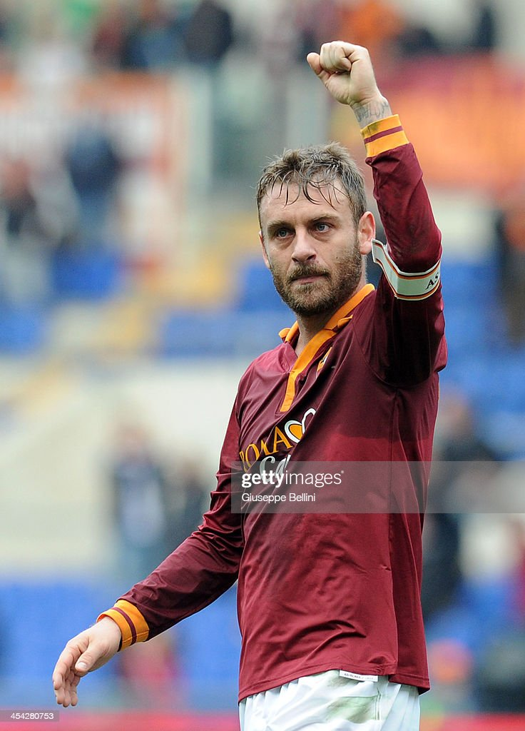 Daniele De Rossi of Roma celebrates the victory after the Serie A match between AS Roma and ACF Fiorentina at Stadio Olimpico on December 8, 2013 in Rome, Italy.