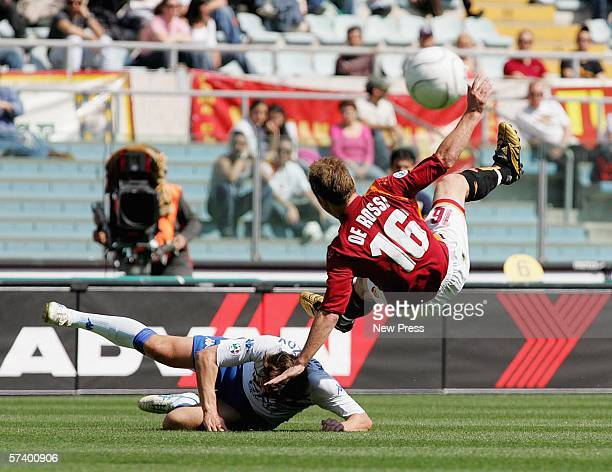 Daniele De Rossi of Roma in action against Vitali Kutuzov of Sampdoria during the Serie A match between Roma and Sampdoria at the Stadio Olimpico on...