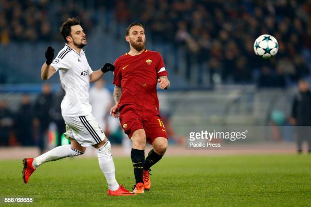 Daniele De Rossi of Roma is tackled by Mahir Madatov of Qarabag during their UEFA Champions League Group C soccer match in Rome Roma won the match 10