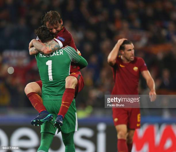 Daniele De Rossi with his teammate Alisson Becker of AS Roma celebrates the victory after the UEFA Champions League quarter final second leg between...