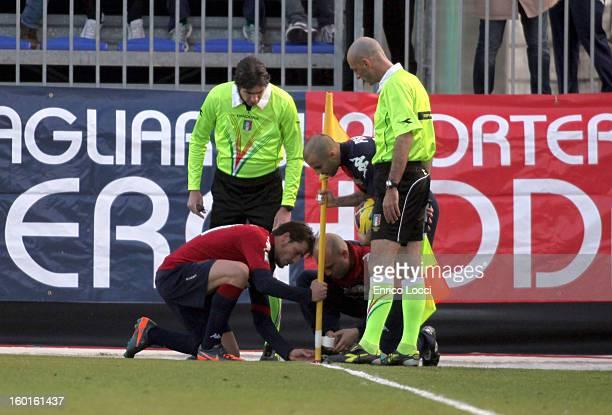Daniele Dessena and Francesco Pisano of Cagliari fix the corner flag during the Serie A match between Cagliari Calcio and US Citta di Palermo at...