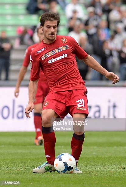 Daniele Dessena of Cagliari Calcio in action during the Serie A match between Udinese Calcio and Cagliari Calcio at Stadio Friuli on October 6 2013...