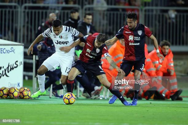 Daniele Dessena of Cagliari in contrast with Alex Sandro of Juventus during the Serie A match between Cagliari Calcio and Juventus FC at Stadio...