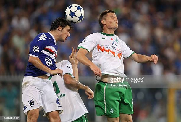 Daniele Dessena of Genua and Markus Rosenberg and Tim Borowski of Bremen compete for the ball during the Uefa Champions League qualifying second leg...