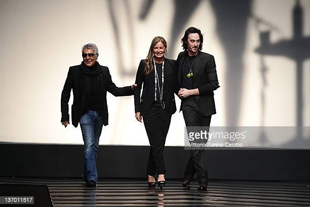 Daniele Eva and Roberto Cavalli aknoledge the applause of the public after the Roberto Cavalli fashion show as part of Milan Fashion Week Menswear...