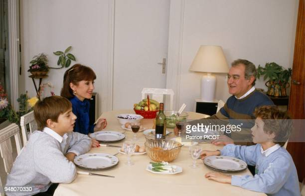 Daniele Evenou with husband Georges Fillioud sons Frederic and JeanBaptiste Martin at home