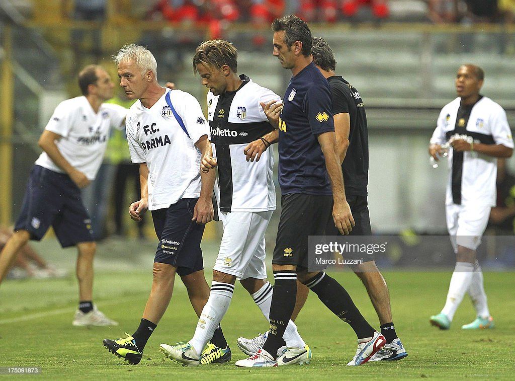 Daniele Galloppa (C) of Parma FC walks off with an injury during the pre-season friendly match between Parma FC and Olympique de Marseille at Stadio Ennio Tardini on July 31, 2013 in Parma, Italy.