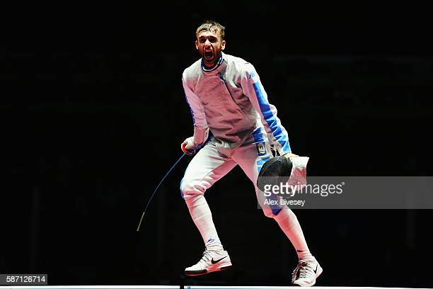 Daniele Garozzo of Italy celebrates victory over Alexander Massialas of the United States during Men's Individual Foil Final on Day 2 of the Rio 2016...