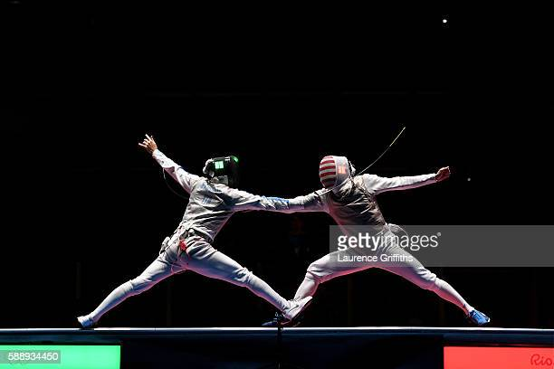 Daniele Garozzo of Italy competes against Gerek Meinhardt of the United States during the Men's Foil Team Bronze Medal Match bout on Day 7 of the Rio...