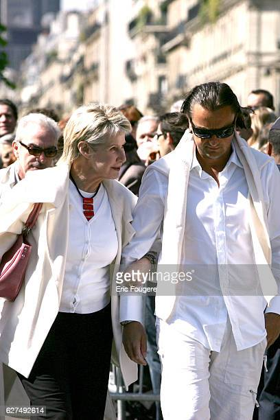 Daniele Gilbert and Henri Leconte dressed in white attend the funeral of French showbiz personality Eddie Barclay