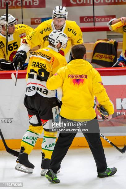 Daniele Grassi of SC Bern being walked off the ice by medic during the Swiss National League game between Lausanne HC and SC Bern at Vaudoise Arena...
