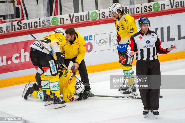 Daniele Grassi of SC Bern stays injured on the ice after clash with Petteri Lindbohm of Lausanne HC during the Swiss National League game between...