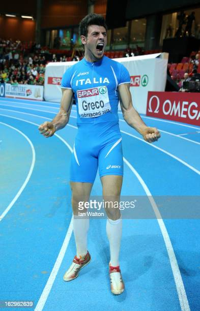 Daniele Greco of Italy celebrates winning gold in the Men's Triple Jump Final during day two of the European Athletics Indoor Championships at...