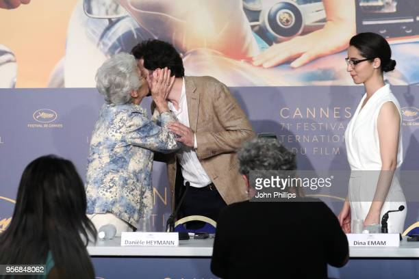 Daniele Heymann greets Director AB Shawky as actress Shahira Fahmy looks on at the press conference for 'Yomeddine' during the 71st annual Cannes...