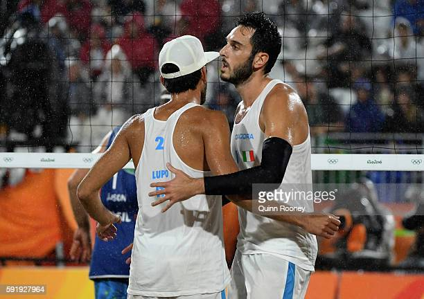 Daniele Lupo and Paolo Nicolai of Italy react during the Men's Beach Volleyball Gold medal match against Alison Cerutti and Bruno Schmidt Oscar of...