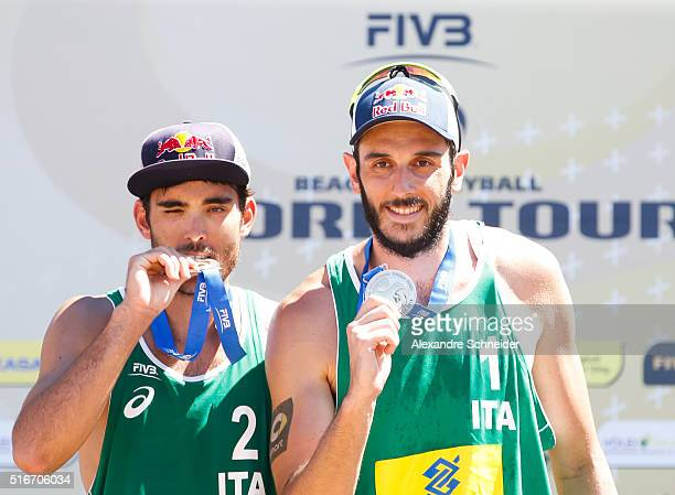 Daniele Lupo and Paolo Nicolai of Italy show the silver medal during awarding ceremony at Camburi beach during day six of the FIVB Beach Volleyball...