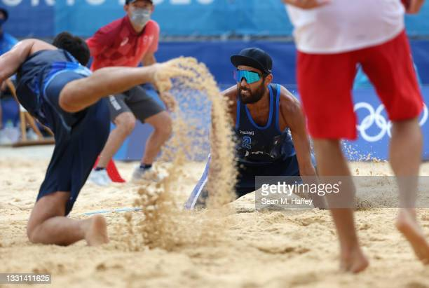 Daniele Lupo and Paolo Nicolai of Team Italy compete against Team Poland during the Men's Preliminary - Pool F beach volleyball on day seven of the...