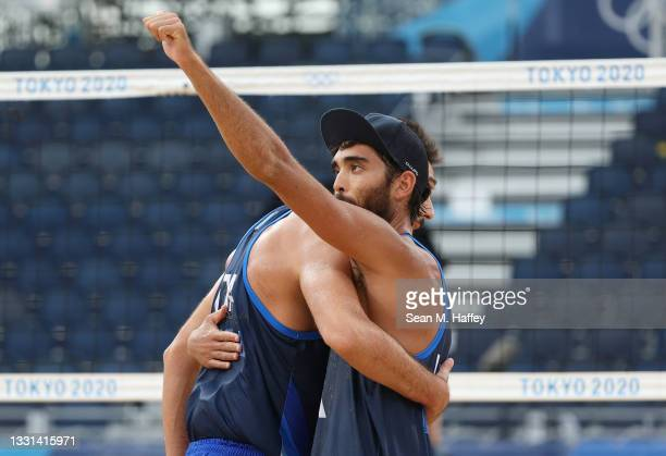 Daniele Lupo and Paolo Nicolai of Team Italy react after defeating Team Poland during the Men's Preliminary - Pool F beach volleyball on day seven of...