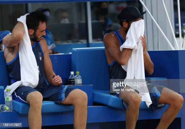 Daniele Lupo and Paolo Nicolai of Team Italy react as they compete against Team Poland during the Men's Preliminary - Pool F beach volleyball on day...