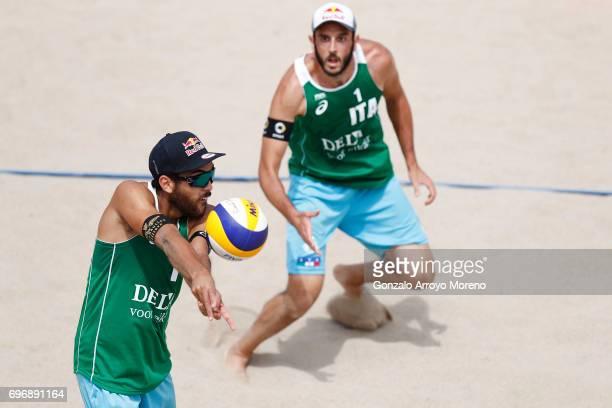 Daniele Lupo form Italy bumps the ball ahead his teammate Paolo Nicolai during their quarter final match against Australia during the FIVB Beach...