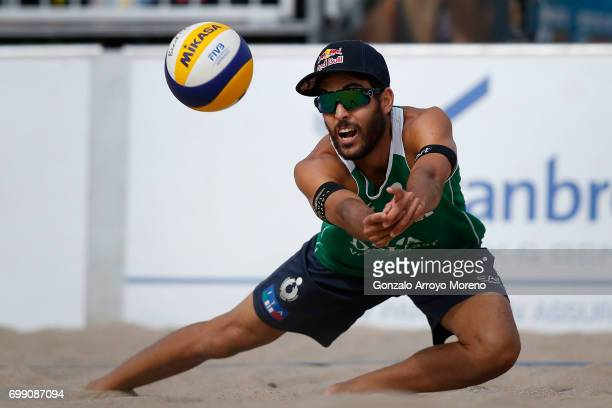 Daniele Lupo from Italy bumps the ball during their match against Belgium during the FIVB Beach Volleyball World Tour at the Sportcampus Zuiderpark...