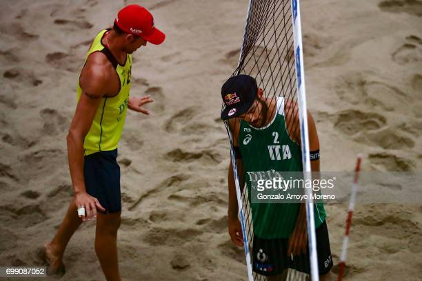 Daniele Lupo from Italy clashes with the net as Pablo Herrera from Spain gestures during their match at the FIVB Beach Volleyball World Tour at the...