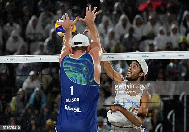 Daniele Lupo of Italy and Alison Cerutti of Brazil battle at the net during the Men's Beach Volleyball Gold medal match at the Beach Volleyball Arena...