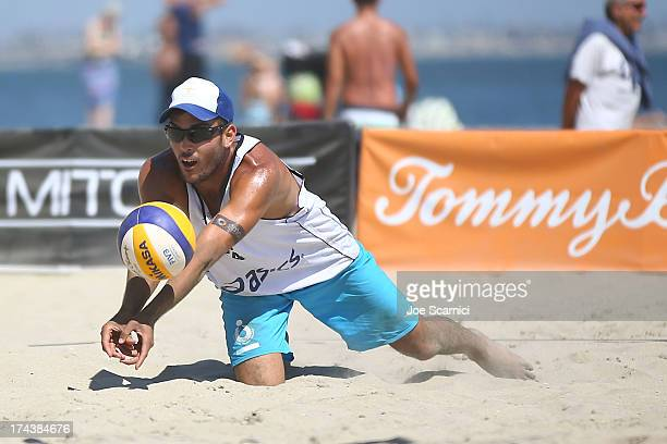 Daniele Lupo of Italy dives for the ball during the round of pool play at the ASICS World Series of Beach Volleyball Day 3 on July 24 2013 in Long...