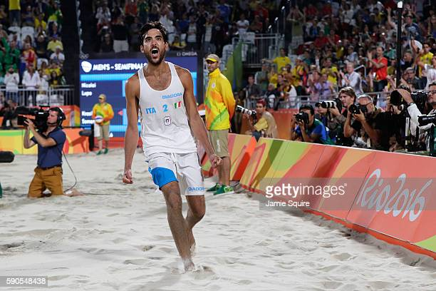 Daniele Lupo of Italy playing with Paolo Nicolai of Italy celebrates winning the beach volleyball Men's Semi final against Viacheslav Krasilnikov and...
