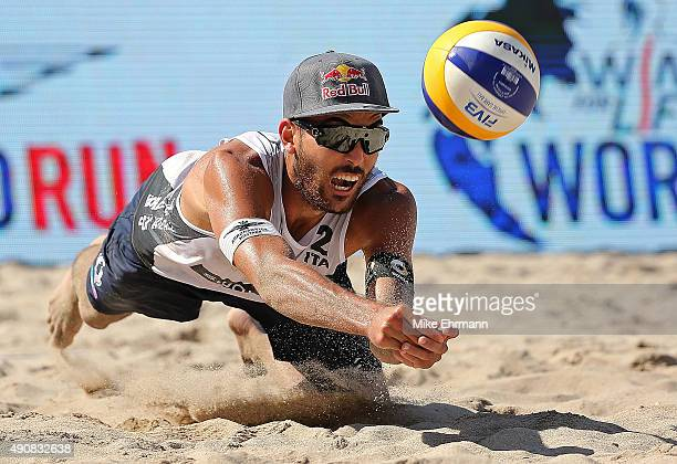 Daniele Lupo of Italy plays a shot during a match against Pablo Herrera and Adrian Gavira of Spain during FIVB Fort Lauderdale Swatch Season Final on...