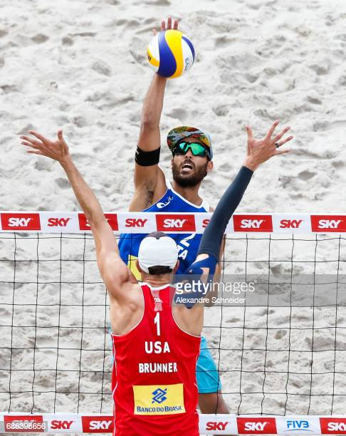 Daniele Lupo of Italy spikes the ball against Theo Brunner of the United States during the bronze medal match at Parque Olimpico during day four of...