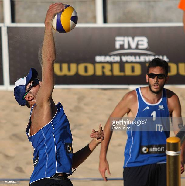 Daniele Lupo of Italy spikes the ball as Paolo Nicolai looks on during the men's main draw of FIVB Smart Grand Slam at Foro Italico on June 19 2013...