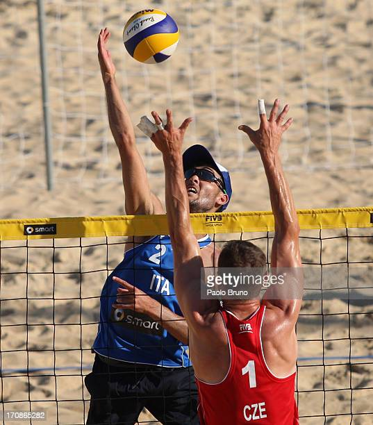 Daniele Lupo of Italy spikes the ball as Premysl Kubala of Czech Republic blocks during the men's main draw of FIVB Smart Grand Slam at Foro Italico...